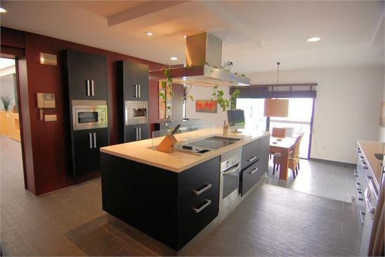Designer kitchen with great views over pool to sea