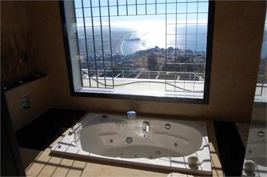 View to sea & castle from tub in main bathroom