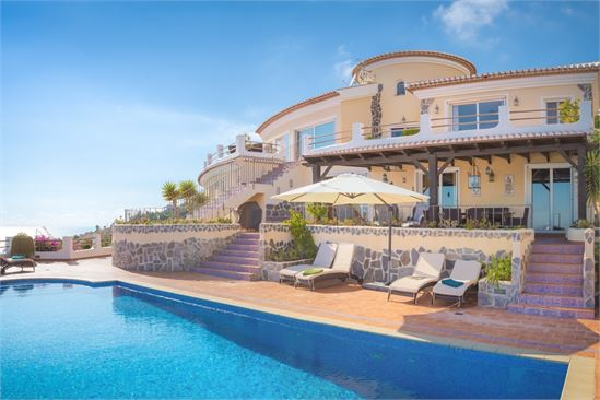 The villa and the pool by day