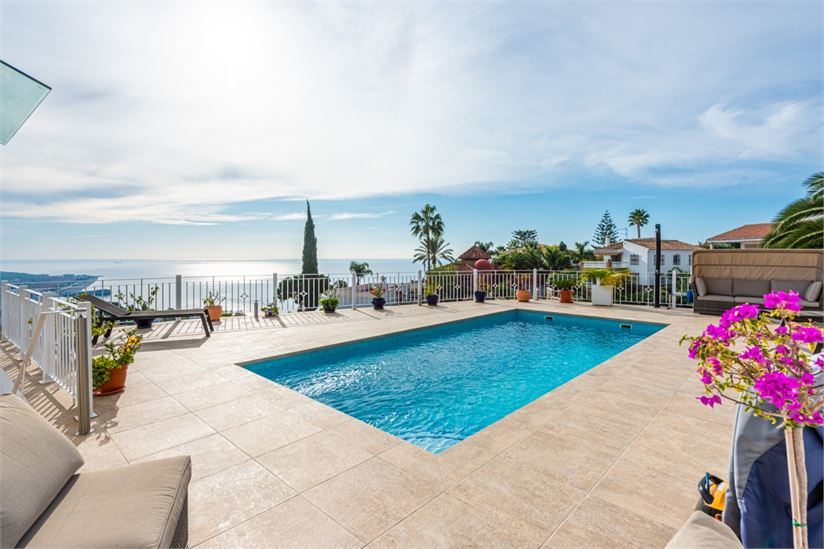 Large terraces around the pool and sea views